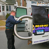 Chimney sweep performs a chimney relining service at Park St Hartford CT