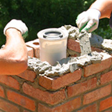Chimney sweeps rebuild a deteriorating old chimney at home on Woodbridge St Manchester CT
