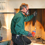 A chimney sweep cleans chimney & fireplace at home on Chestnut Hill Rd Glastonbury CT