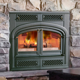 Chimney experts install a fireplace insert at home on Capitol Ave Hartford CT